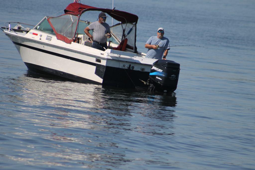 Buddies on Small Boat fishing