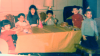 all_of_us_around_the+table_eating_birthday_cake_wide_sat_color_sm.png -